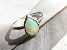 opal engagement ring, opal promise ring, white opal ring silver, welo opal ring, womens personalized ring, anniversary gift womens opal ring by CrazyAssJD on Etsy https://www.etsy.com/listing/241581407/opal-engagement-ring-opal-promise-ring