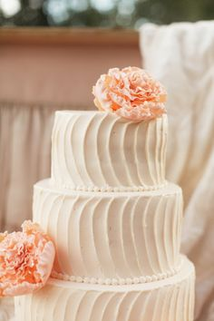 Gorgeous 4 tier wedding cake with pale pink cream cheese icing and dusty peach sugar flowers.