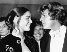 """Ali MacGraw Ryna O'Neal: FILE- In this March 8, 1971, file photo, Ryan O'Neal, right, and Ali MacGraw smile after their arrival at the Odeon Theatre, Leicester Square in London, to attend the Royal Film showing of """"Love Story."""" Actors MacGraw and O'Neal are returning to Harvard University more than 45 years after the release of their 1970 classic """"Love Story."""" The duo, now in their 70s, will be reflecting on their careers Monday, Feb. 1, 2016, in a conversation moderated by arts journalist…"""
