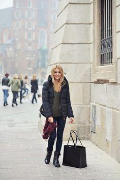 puffer, olive sweater, dark jeans, black bag & booties, burgundy beanie