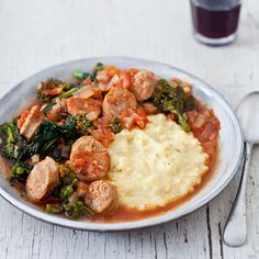 Sausage and Broccoli Rabe with Polenta | Spicy Italian sausage and broccoli rabe simmer in a flavorful tomato sauce. Served over a mound of creamy polenta, they make a ravishing, rustic Italian meal for a cold winter's night.