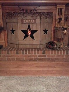 Primitive wooden fireplace cover for summer