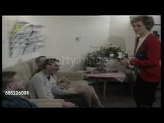circa 1989: Princess Diana at the London Lighthouse AIDS Support Centre: Princess Diana (wearing a red jacket) attending fund raising event for AIDS research. Rare footage. Video.