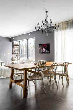 Flos lamp by Sarfatti. Möckelby dinner table Ikea. Café chairs Ikea. Wall art by FormentoFormento Yellow Korner.
