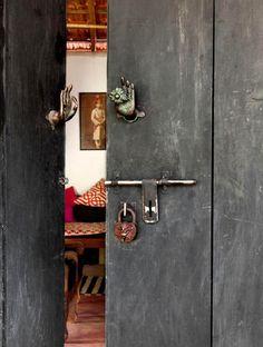 Jade Jagger's Indian Abode - Buddha hand door hardware