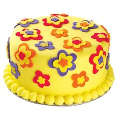 How does your garden glow? Not as brightly as the fondant blossoms on our Funny Flower Power Cake! We cut the layered petals from Primary and Neon Fondant Multi Packs using our Funny Flower Cut-Outs.