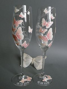 Hand painted Wedding Toasting Flutes Set of 2 Personalized Champagne glasses White and pink Butterflies love flight. $49.00, via Etsy.