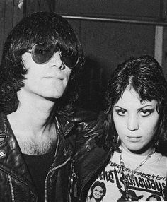 """Dee Dee Ramone and Joan Jett  (1951 - 2002) was a German-American songwriter and musician, best known as founding member, songwriter, and bassist for punk rock band the Ramones. Though nearly all of the Ramones' songs were credited equally to all the band members, Dee Dee was the band's most prolific lyricist and songwriter, writing many of the band's most well-known songs, such as """"53rd & 3rd"""", """"Commando"""" and """"Poison Heart"""". He died of a heroine overdose."""