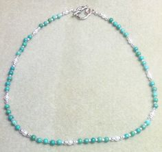 I love the simple design and this necklace is simply and pretty I created this Turquoise & Swarovski Pearl Necklace using 4mm Turqoise Rounds Grade B and Swarovski Crystal White Pearls 4mm separated b