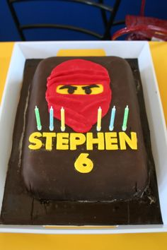 lego red ninja cake -Maybe with white frosting and blue ninja?