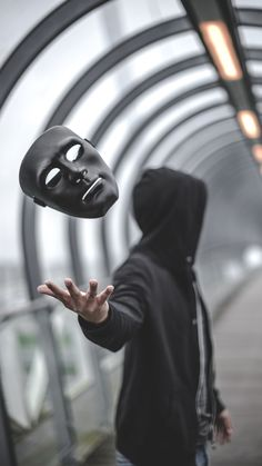 I really enjoy this photo especially how the shutter speed was able to get the image of the mask falling and how they got it to face the camera. but I don't like the fact the actual man is blurred into the background Dark Photography, Creative Photography, Portrait Photography, Artistic Photography, White Background Photography, Alone Photography, Photography Tricks, Monochrome Photography, Nikon Photography