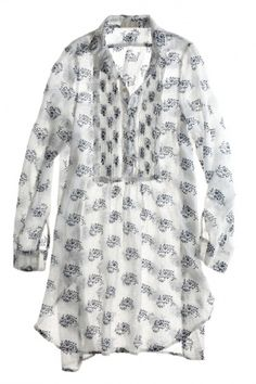 tunic. White with black print. Very light and airy, with a bib front.