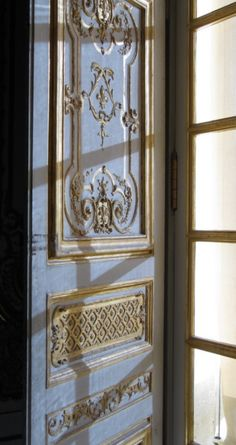 This exquisite interior window shutter with decorative mouldings, was photographed at Versailles.