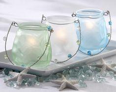 lit jars with seaglass and starfish
