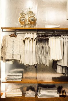 I absolutely love how the wooden tones in the shelving work so beautifully with the exposed walls and most of all the golden mercury urns set it all off. Banana Republic | New York City