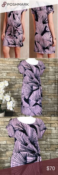 """Anthropologie Maeve Blue Pindo Tunic Dress Maeve comfortable Pindo Tunic Dress with side tie. Pullover styling. Short Sleeves. Dress is Purple throughout. Material 95% Rayon, 5% Spandex.  Size XS   Measurements (laid flat) Armpit to armpit 18"""" Waist 17"""" Length 37"""" from top of shoulder   Condition New without tags. No flaws noted. Note line on the brand to prevent in-store return. Anthropologie Dresses"""