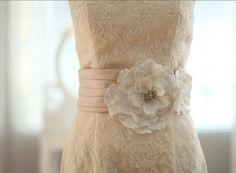 I think i need this for my rehearsal dinner dress!   https://www.etsy.com/listing/157077131/champagne-satin-ivory-flower-belt-sash