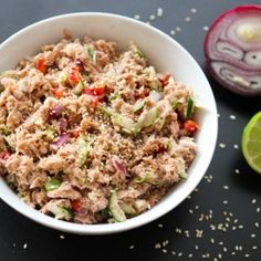 Acapulco Tuna Salad: 2 cans tuna, 6 ounces each and low in sodium 1 medium tomato, diced 1/2 small sweet onion, finely chopped 1 jalapeño, diced 2 tablespoons low-fat mayonnaise or regular mayo made with olive oil 1 tablespoon lime juice