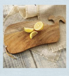 Whale Cutting Board. Create a nautical style for your kitchen. Mango wood cutting board has been carved in the shape of a Whale. Use when cutting vegetables or fruits; use as a serving board for cheese and crackers. When not in use, hang as a decorative accent.