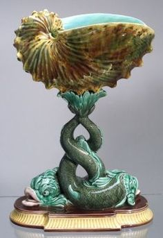 Wedgwood Majolica Dolphin Compote, England, c.1866, the bowl molded as a nautilus shell, the base as two dolphins with entwined tails,