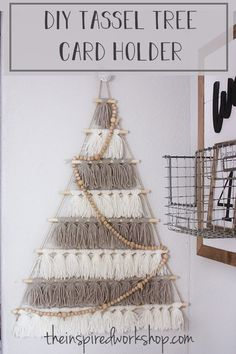 DIY Tree Card Holder Made of Tassels - Make this cute little tassel tree with a couple dowel rods and yarn! Hang photos, Christmas cards or anything you want to display! The Christmas card holder will display all your holiday cards in a stylish way that you can't find in stores! Make it for yourself or give it as a gift to someone who you know loves modern or farmhouse decor! #christmascardholder #yarndecor #woodbeadgarland