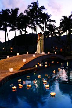 The Aloha Lani wedding package at the Kauai Marriott Resort gives that perfect romantic candlelit Hawaiian bridal processional-- complete with conch-shell blowers! | Kalapaki Beach, Hawaii