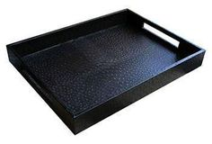 This tray feels incredibly luxe with its faux-ostrich texture and chic black color.