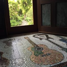 Guitar entryway... There are more. ‪#‎mosaic‬ design ‪#‎sallytaylor‬. On Carly Simon's Facebook page. https://www.facebook.com/CarlySimonOfficial/photos/a.188561702474.129691.20486807474/10152901151407475/?type=1&theater