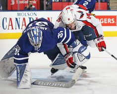 TORONTO, ON - APRIL 17: Justin Williams #14 of the Washington Capitals bumps into goalie Frederik Andersen #31 of the Toronto Maple Leafs in Game Three of the Eastern Conference Quarterfinals during the 2017 NHL Stanley Cup Playoffs at the Air Canada Centre on April 17, 2017 in Toronto, Ontario, Canada. The Maple Leafs defeated the Capitals 4-3 in overtime.(Photo by Claus Andersen/Getty Images)