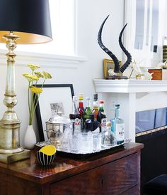 The bar is often the hub ofa party, so it's important that it looks the part. Whether you transform your console into a drinks station or mix martinis from a brass cart, here are 8 ideas for a stylish home bar.