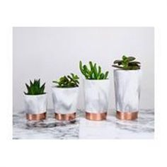 Copper dipped marbled black and white concrete pots