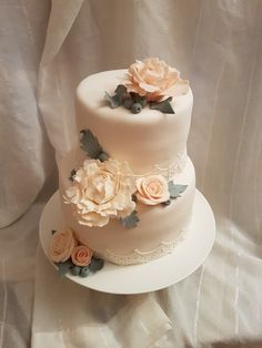 Elegant two tier cake with flowers and lace