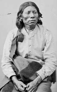 Kitsai Chief Knee-War-War in partial native dress with ornaments, 1872.