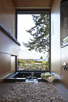 "We like how this tub focuses on the view, rather than ""here is the tub!"" and there is a view somewhere behind it. Also a great idea to have your tub sunken or at least appear so."