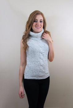 Kambo Knit $37.99 Turtle neckline Cable knit detail Uneven hemline Cotton, Polyester #SkyeBoutique
