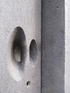Door handle on basaltic rock door at chapel - Kolumba, Koln, Germany. [Architect: Peter Zumthor/Gottfried Bohm]