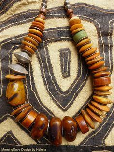 by Helena Nelson-Reed | Old African bone buttons which have been lovingly polished, an antique glass Hebron bead, several thick antique Tibetan bone beads, antique Ethiopian coin silver beads, contemporary mock amber and large contemporary fine silver beads from the Hill Tribe.  {350$}