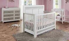 The Cortina Forever Crib with white cushioned headboard