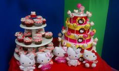 This was my first Hello Kitty Presentation. Chocolate cupcakes with Butter Cream Frosting and Fondant Hello Kitty Decor. Next to a Dummy cake made of Styrafoam Decorated with ribbons, card stock and Cake Pops!