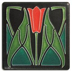 The whiplash floral motif on this tile is pure art nouveau, while the way the border melds with the design is pure Motawi.
