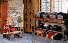 cute cabin decor. love the table and bins