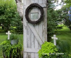 Serenity in the Junk Garden with Shabby Crosses and an old Barn Door.