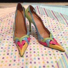 "Stuart Weismann multi colored heels Stuart Weismann has done it again with these very lovely multi colored leather 4.5""heels. These shoes would knock out your blue, green, pink or yellow outfit. A stone cold shoe stopper. These are pre owned and I'm sure you will love them too. Stuart Weitzman Shoes Heels"