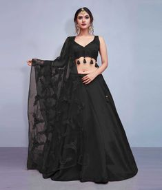 It can be cutomized upto Bust & Waist Size 42 inches Work Type: Thread Embroidery with Flowers & Tassels Blouse Color: Black Lehenga Color: Black Dupatta Color: Black Blouse Fabric: Art Silk Lehenga Fabric: Art Sil Lehenga Choli Designs, Ghagra Choli, Wedding Lehenga Designs, Bridal Lehenga Choli, Silk Lehenga, Banarsi Saree, Latest Lengha Designs, Silk Dupatta, Indian Fashion Dresses