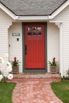 Love the red door and dark trim