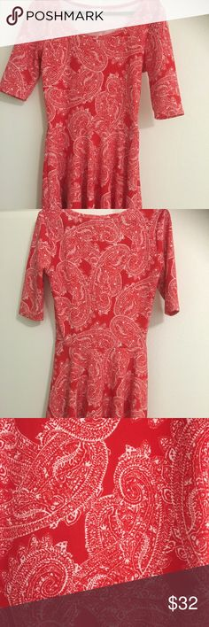 NWOT LuLaRoe Nicole Dress, Size Small Stunning LuLaRoe Nicole Dress, colors are Red, and White, with Paisley Design. The Nicole Dress is fired in the bodice, with a circle skirt. Very Pretty! Like New! LuLaRoe Dresses