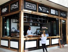 Maze Cafe - UNSW - Will & Co - Mobius Build - Benson Studios - Recycled Timber - unique fitout with different material selection's ranging from recycled timber fixed to existing facade, exposed concrete soffit, black steel shelving, black wire cage industrial pendants with edison light bulbs, blackboard, white ceramic tiles, new s/s wash area and new black epoxy flooring. The design and constructability of this space recreated a new hotspot for coffee goers!
