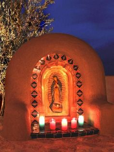 This shrine to Our Lady of Guadalupe is a very common site in New Mexican backyards. It is a calm place, very convenient to the home, for the family to spend time in worship. The adobe structure and decorative tiles are authentic to Mexican design. Design by Classic New Mexico Homes
