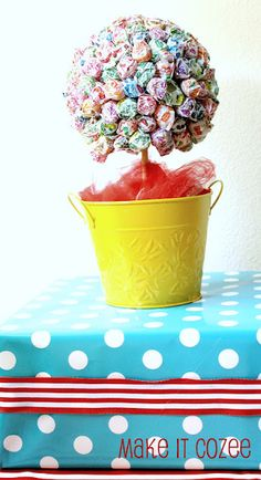 For a decoration, create this truffula tree. Then invite your guests to take a pop for free.