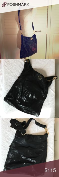 Tory Burch Handbag Authentic Tory Burch Handbag comes in soft black leather and gold hardware. This bag can carry a lady's needs and wants. It was my favorite go to bag as it is in used condition. The leather does show some wear and the interior is in used condition. The handbag has one attachable interior mirror, one zip pocket, and two slide in pockets. The crossbody strap is detachable. Tory Burch Bags Crossbody Bags